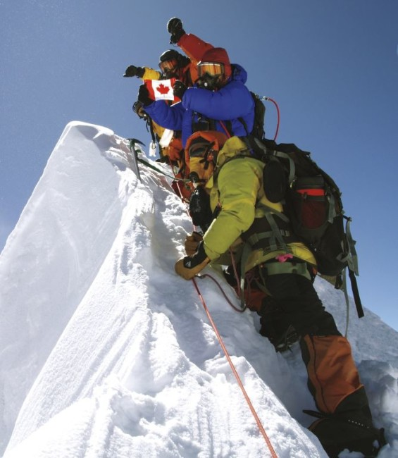 In the thin air of Manaslu's 8,156-metre summit. From top, Mel Proudlock (yellow jacket), Val Pitkethly (red jacket), Helen (blue jacket, with flag), and Tensing Sherpa (green jacket). Picture by Rob Casserley, 2009.