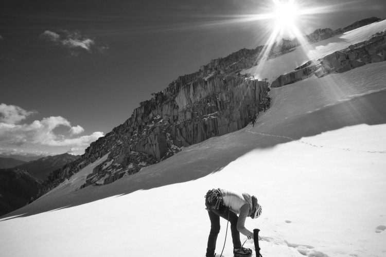 Climbing at the Conrad Kain Bugaboos Teen Camp by Tyra Joe. Guide Jen Olson in front of Hound's Tooth Spire. Tyra was awarded a certificate for 2 nights for 2 people at an ACC backcountry hut.