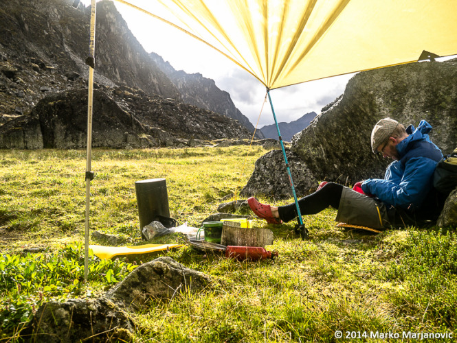 """Peter Knamiller relaxing in the evening sun at """"Milk & Honey"""" camp. That evening we awoke to a sky full of Northern Lights."""