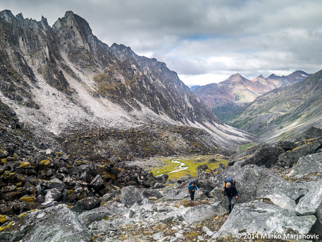 Author Lyn Elliot and Peter Knamiller climbing out of the boulder-filled Valley of Chaos.