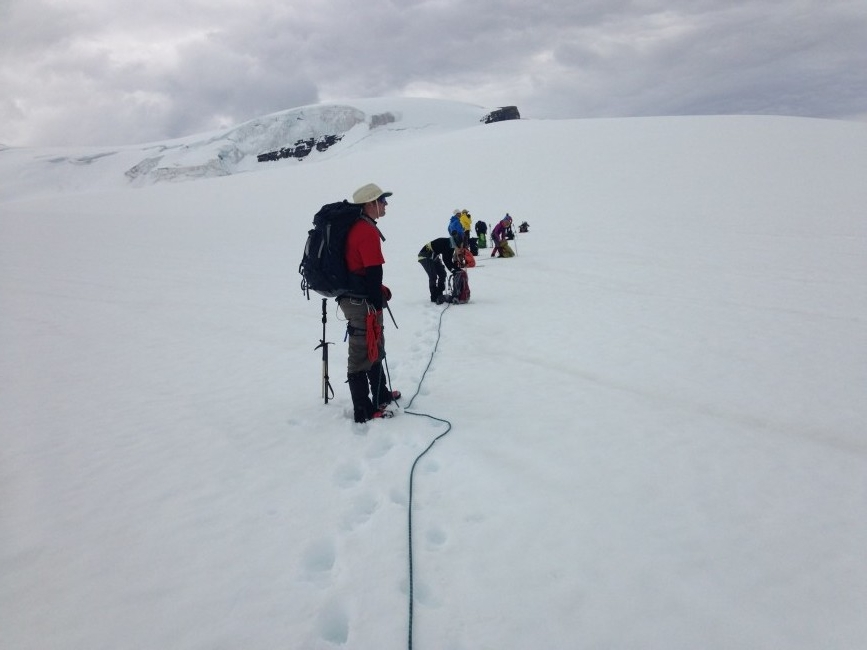 "The newly donned teams ""Lame train"" and ""Gain train"" crossing the Wapta Icefield with the goal of climbing Mount Gordon. This photo was taken just before Peter's moustache started tingling, a sure sign of a storm brewing…and we got only a little bit wet. Photo by Kristy Davison."