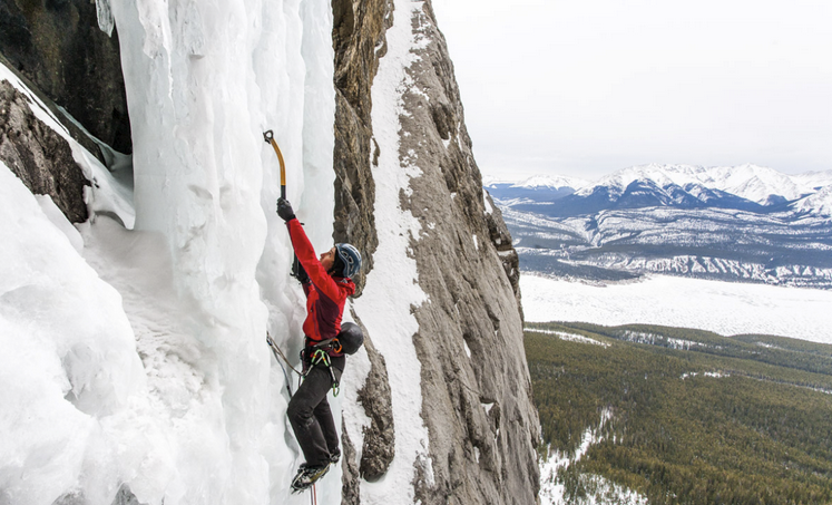 Kendra Stritch ice climbing on Kitty Hawk, Bighhorn Backcountry. Photo by Rafal Andronowski, The Alpine Start.