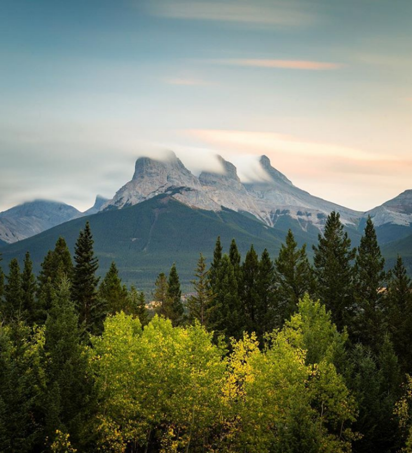 The view of Three Sisters from the ACC Canmore Clubhouse hostel. Photo by Taylor McColl (@taylor.mccoll).