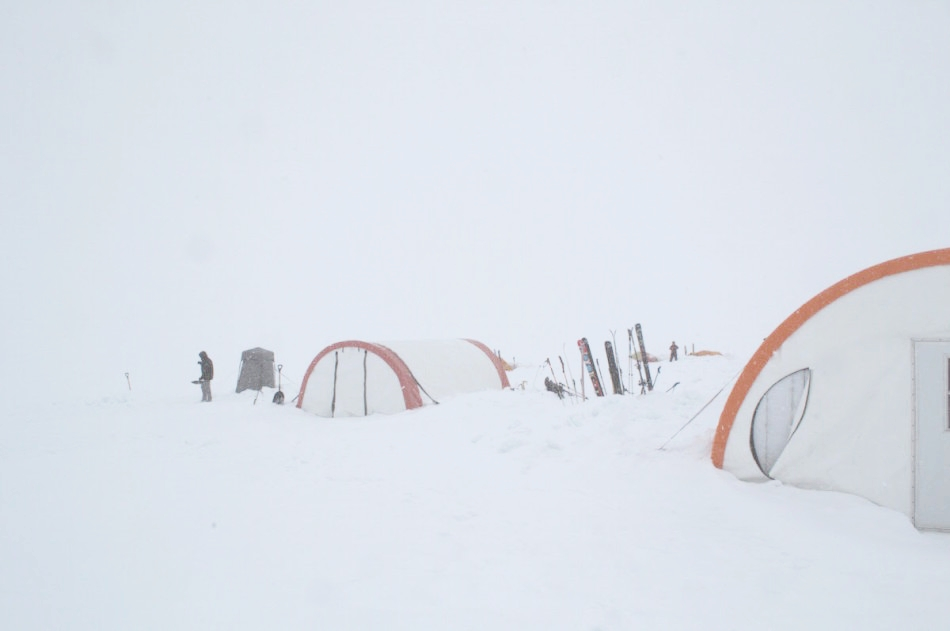 Hanging around camp during a whiteout. Photo by Martin Hoffman.