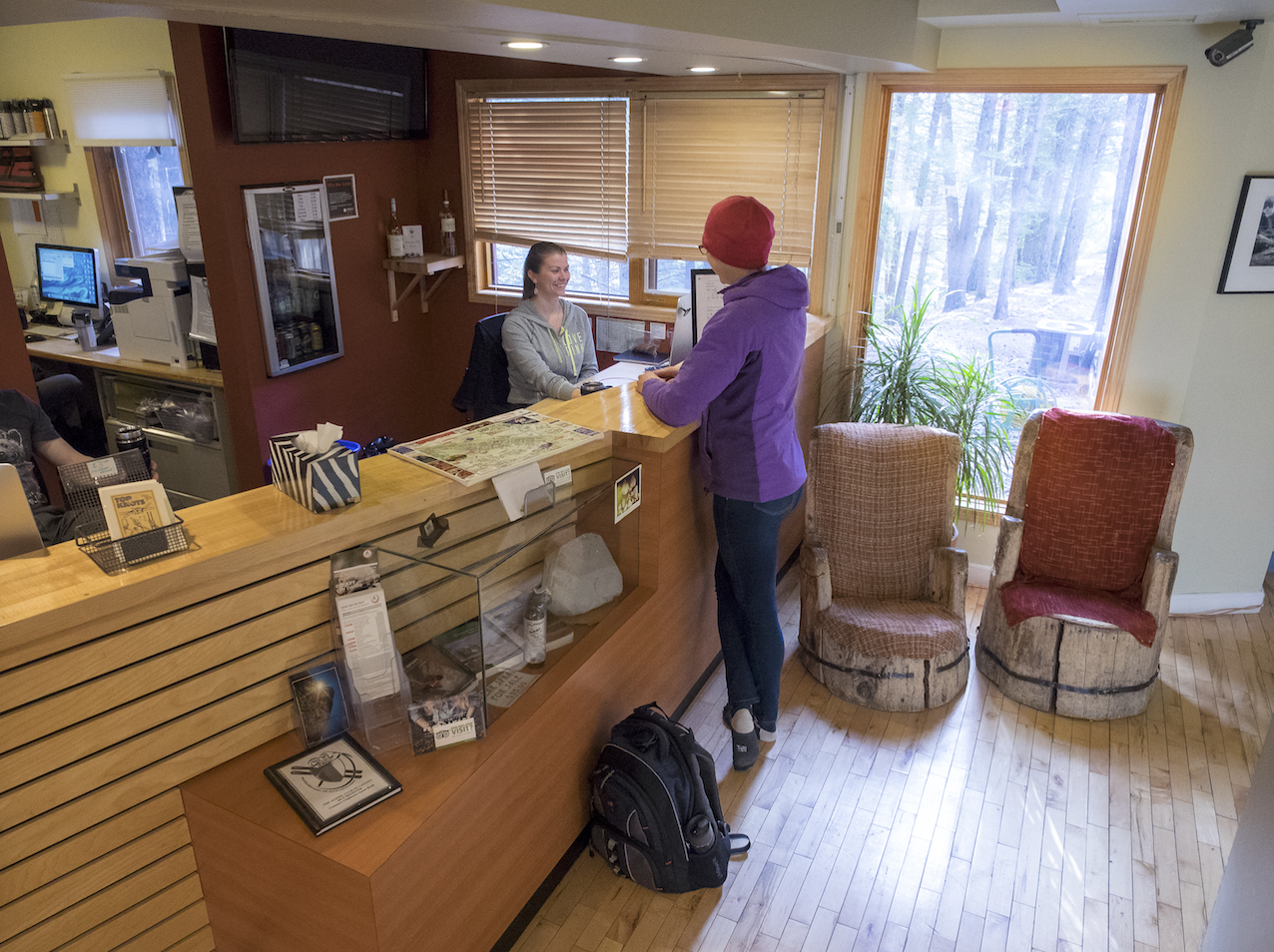 The friendly front desk staff at Canmore Clubhouse. Photo by Leigh McClurg @pebbleshoo.