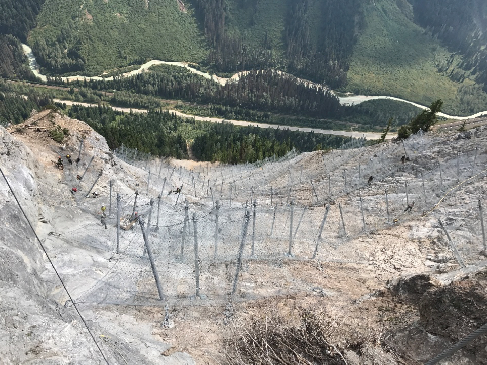Figure 3 : Installation of snow nets in Cougar Corner, 10 km west of Rogers Pass (source: Brian Gould, Alpine Solutions Avalanche Services)
