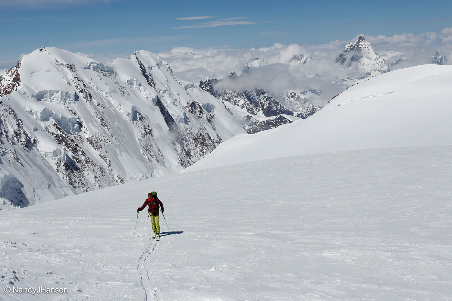 Ralf Dujmovits skiing at about 4,000 m on the Swiss / Italian border. Lyskamm (4,527 m) and the Matterhorn (4,478 m) are behind him. Photo by Nancy Hansen.