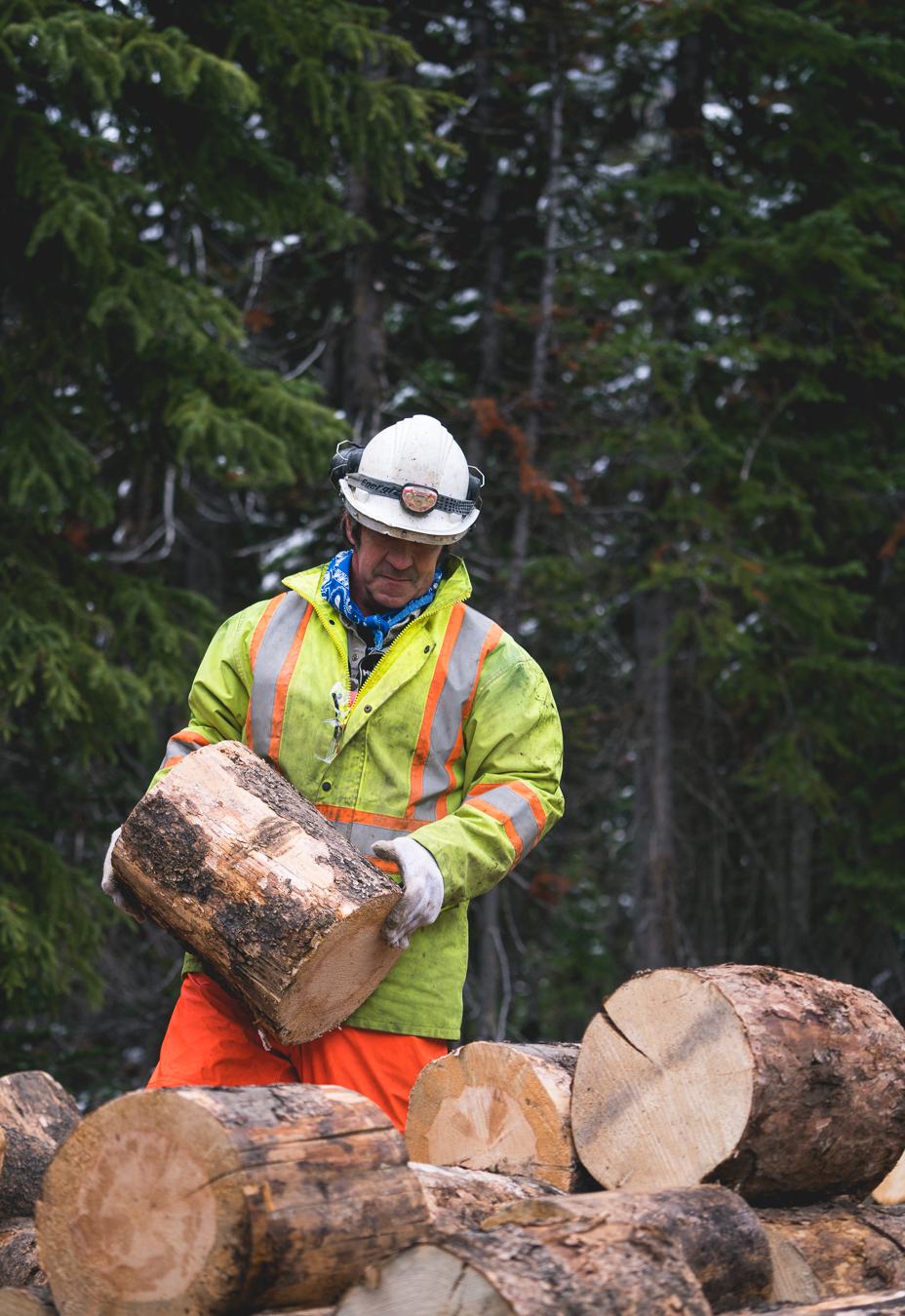 Septic cleanout crew piles wood to be flown into EP.