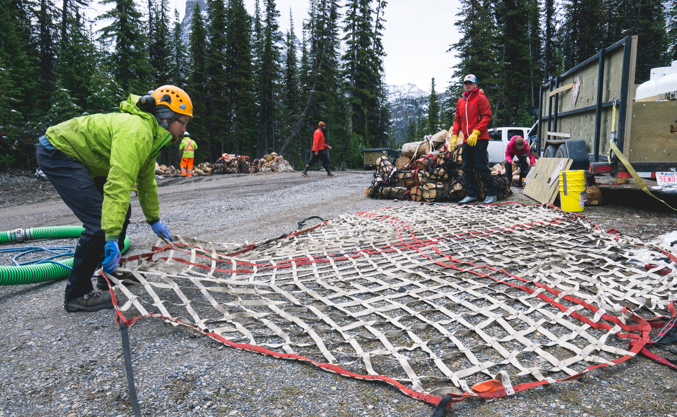 Prepping cargo nets to carry in anything from wood to barrels full of supplies.