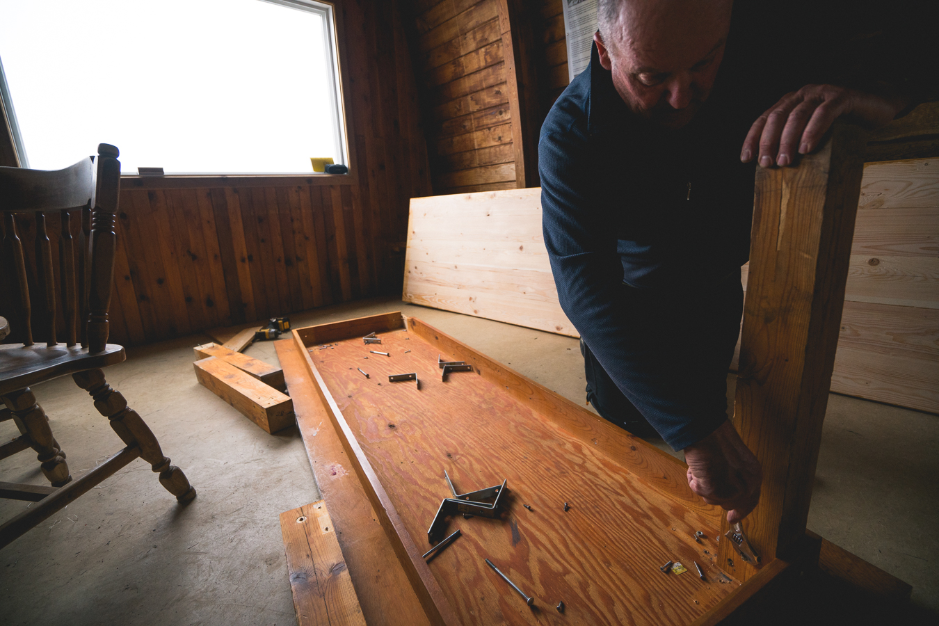 Mike deconstructs the old tables to be flown out.