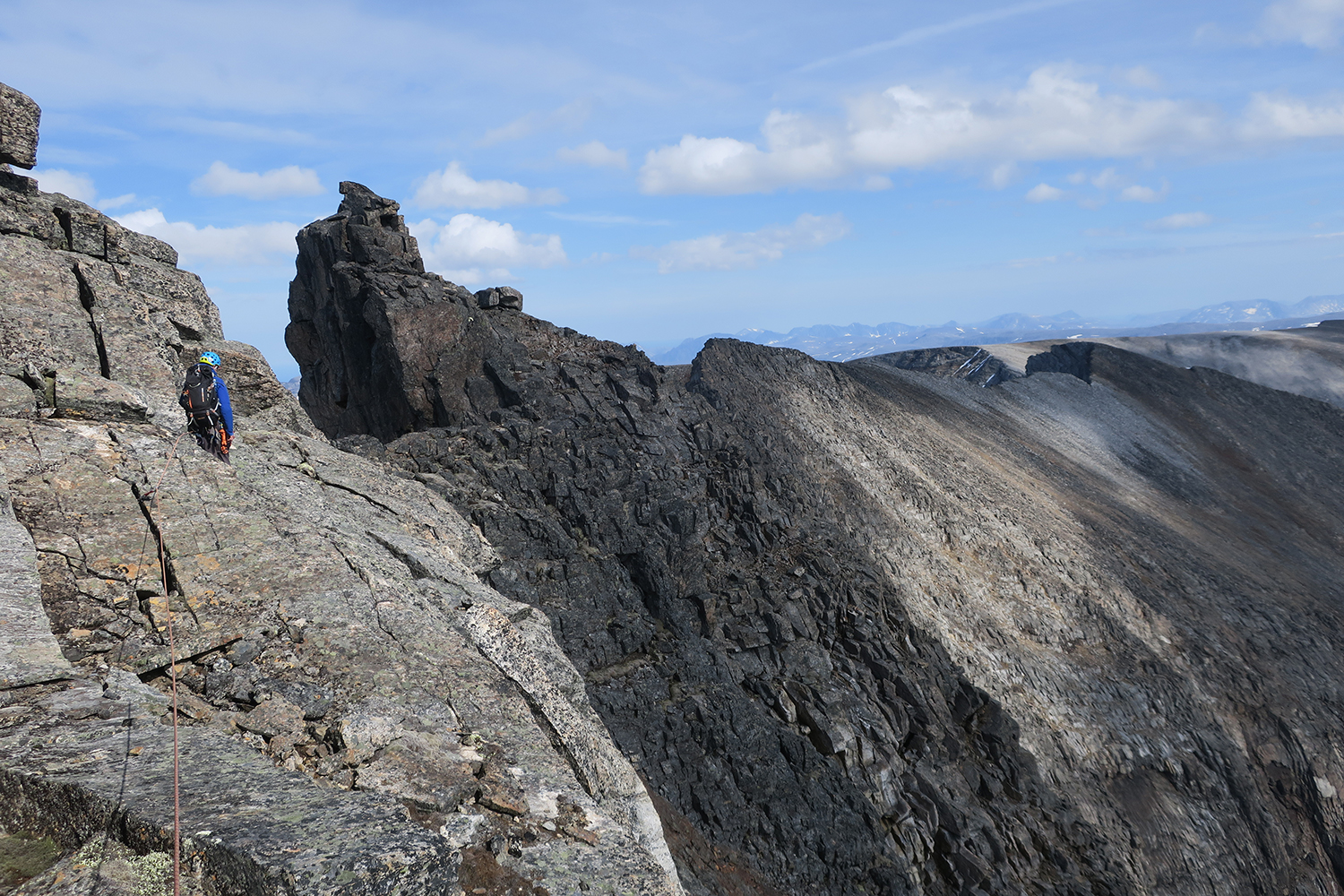 Mike and route finding on the return with the summit now behind us.Photo: Paul Denys