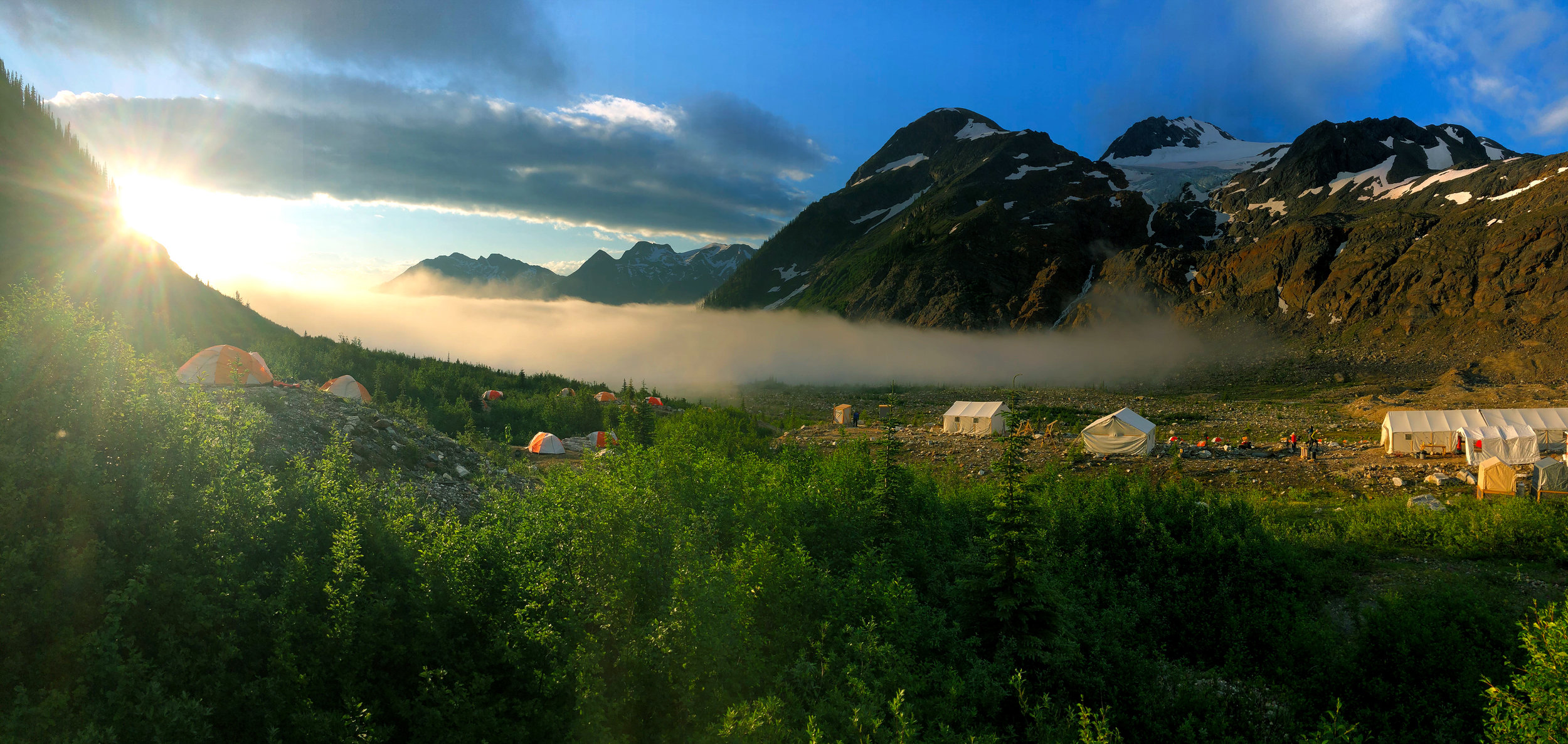 Morning fog rolling into basecamp, ultimately filling the whole valley floor. This fog burned away shortly afterwards, but was a precursor to weather that produced lightning, thunder and hail later that day. Photo: Ray Hope.