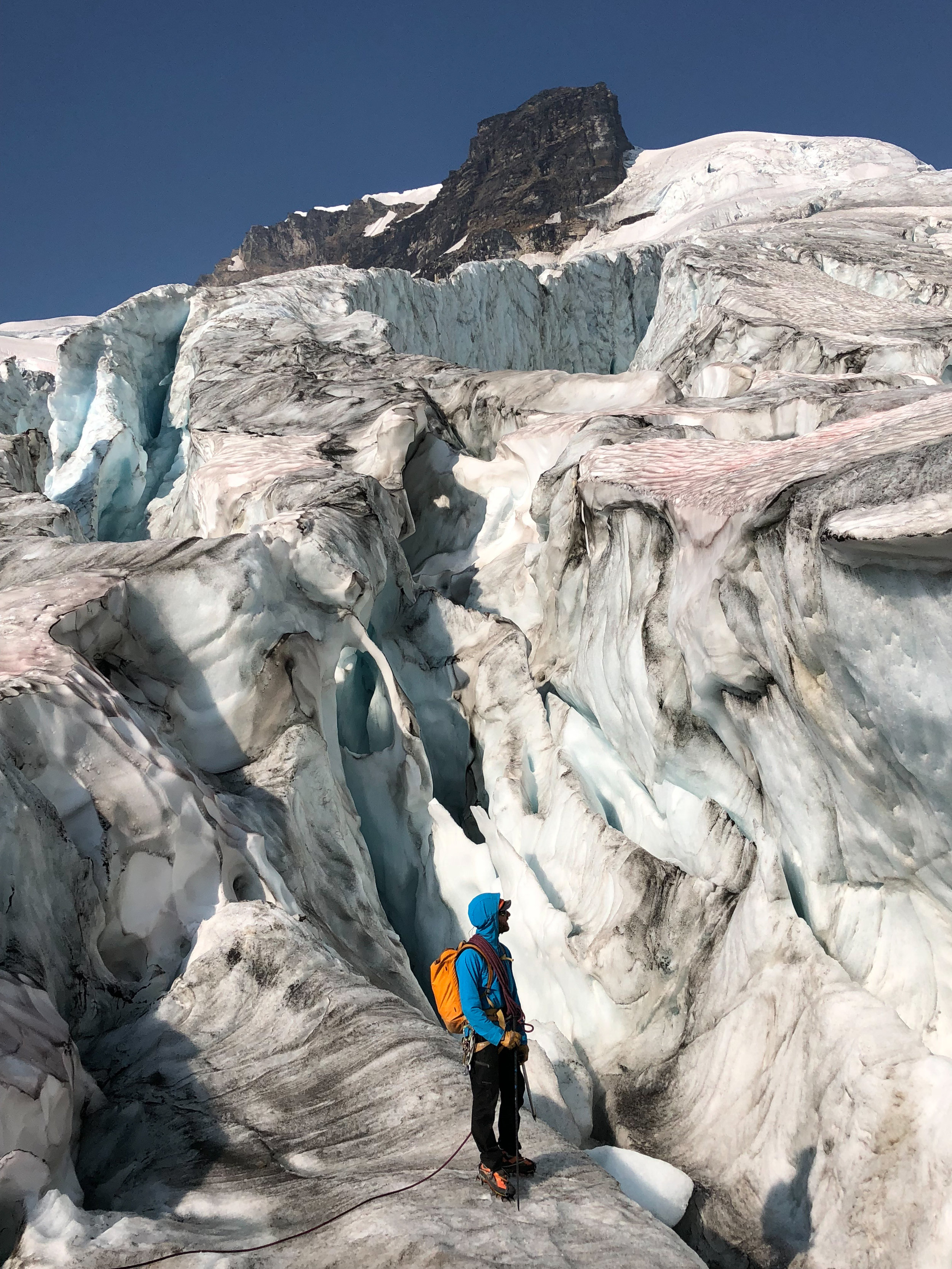 By that time the snow had melted off the glaciers exposing their inner beauty. We spent one day exploring the glacier as we couldn't find a route through it to the col, it was utterly sublime to wander through its wondrous melted shapes. That is our guide Ben Paradis on the glacier.  Photo: Sally Baydala.
