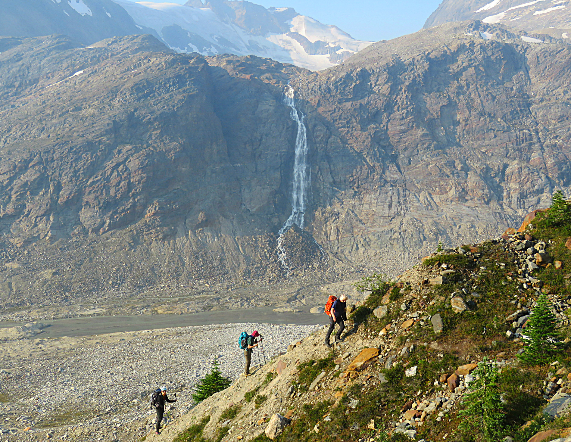 Roger Laurilla leading a hiking group up the moraine above camp to spend a day exploring the high alpine meadows.  Photo: Roy Miller.