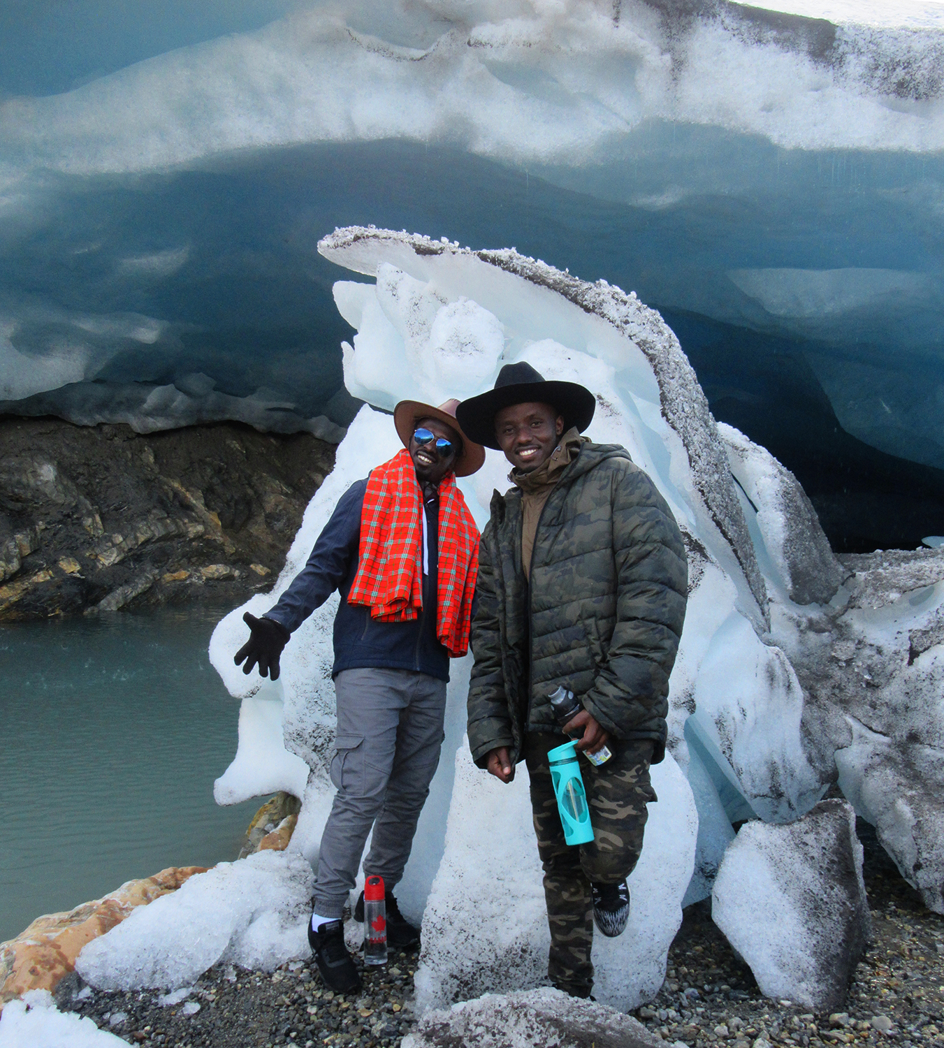 Exploring the ice cave that recently formed at the toe of the Bow Glacier. =