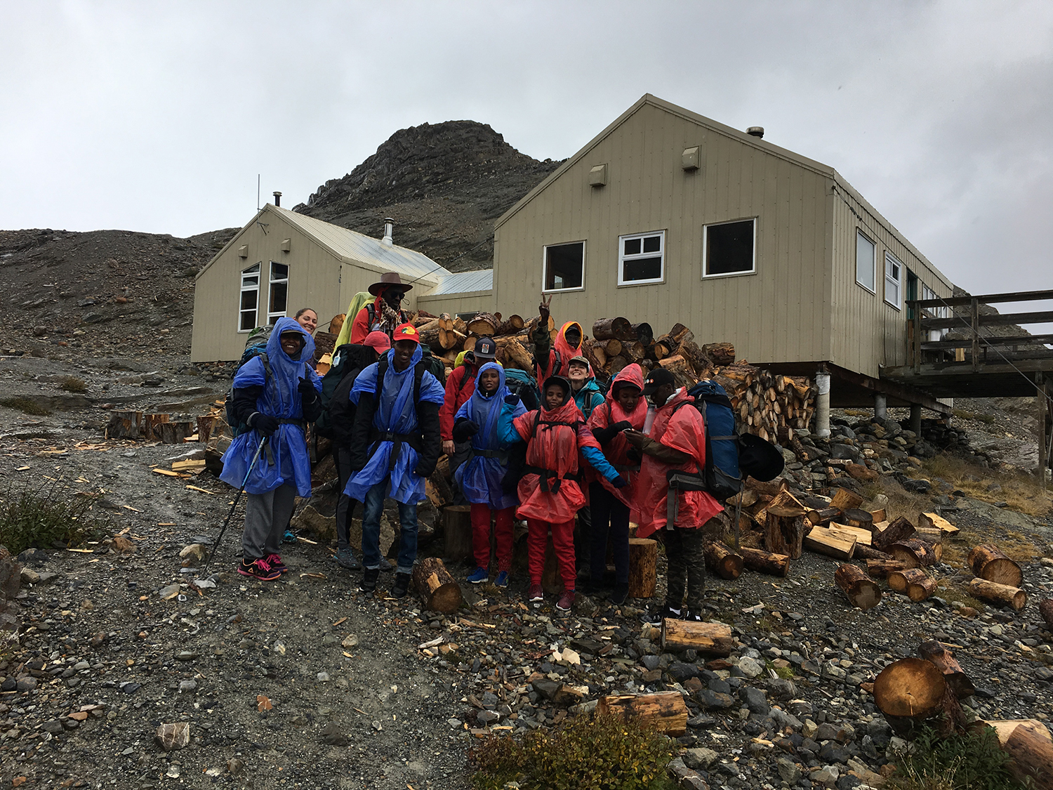 Our whole group in front of Bow Hut. The ponchos were precautionary; we ended up just missing the snow and sleet.