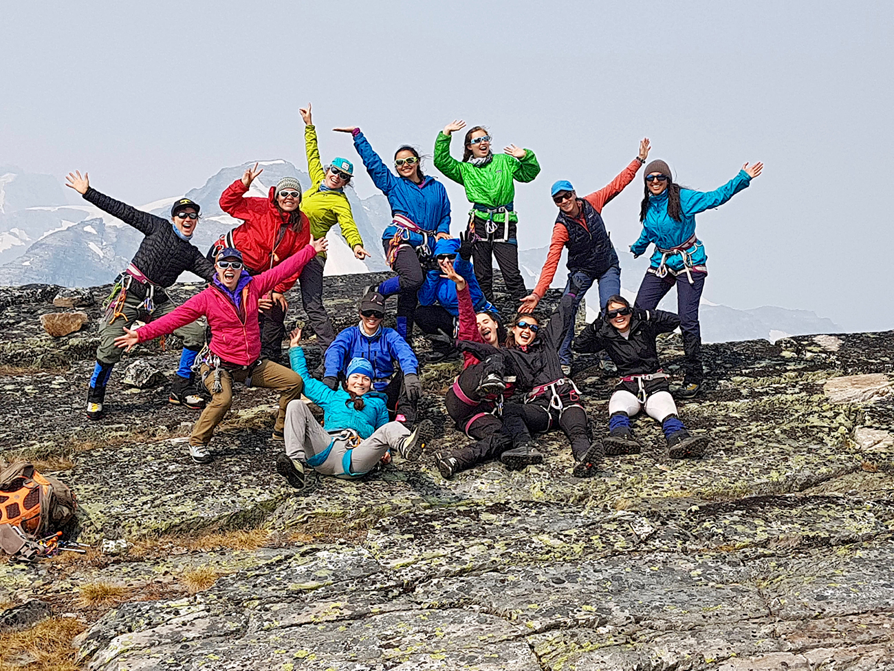 Back row (left to right):  Rosemarie Smith, Haylee Yellowbird, Cece Mortenson (mountain guide), Salimah Steffensen, Chloe Urbanowski, Allison Andrews (mountain guide), Alyana Lalani.   Middle row:  Ellie Bash (glaciologist), Olivia Smith, Yumna Sakkar, Leilu Munro, Kaya Oro Martin, Jordanna Young.  Centre front: Jocelyn Hirose.