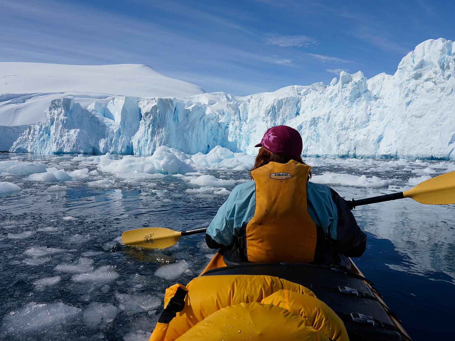 Sea kayaking amid ice and seracs. Photo by Ralf Dujmovits.