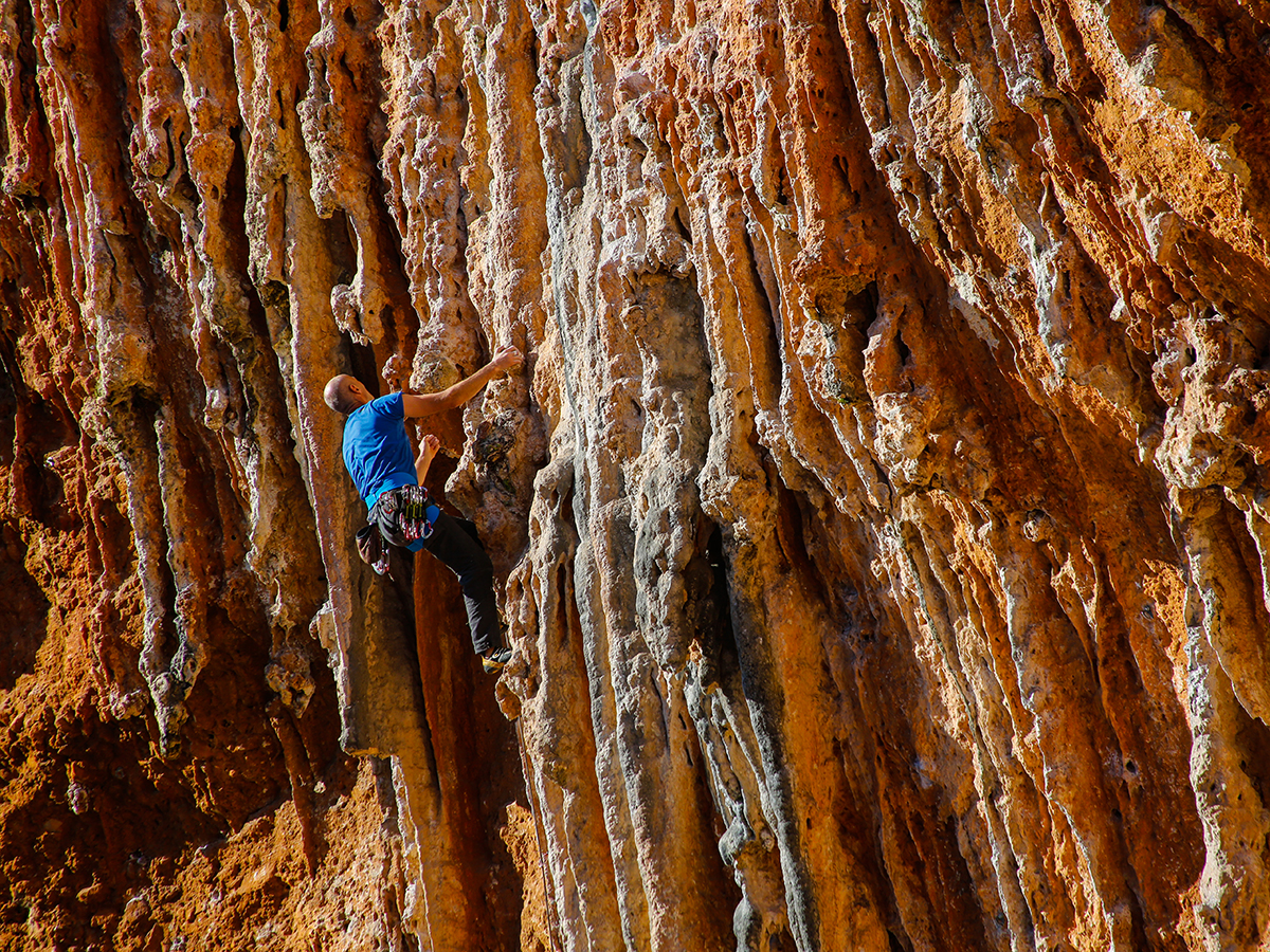 Michael Hummel climbs one of the fun, moderate-grade tufa routes at 'Mars' sector near Leonidio. Photo by Nancy Hansen.