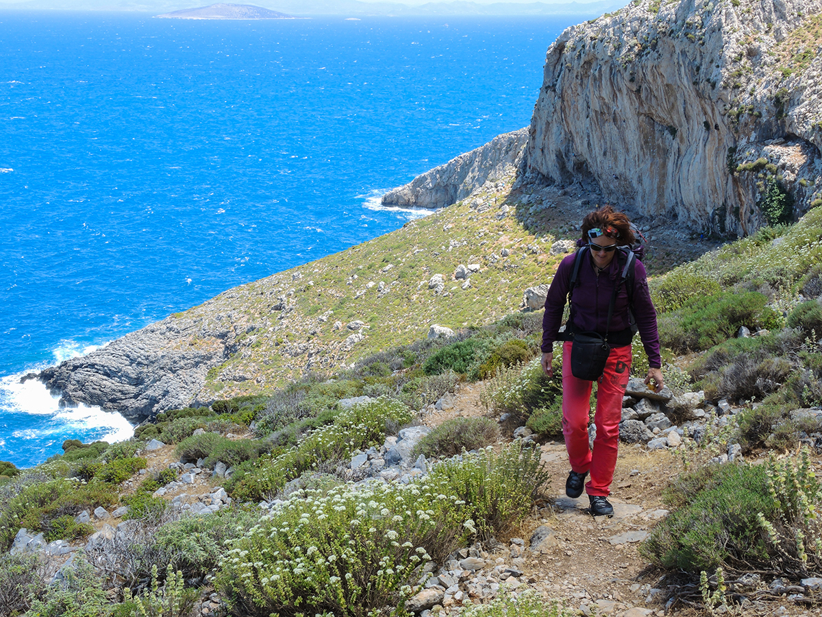 Nancy hiking home from 'The Secret Garden' sector, Kalymnos. Photo by Ralf Dujmvoits.