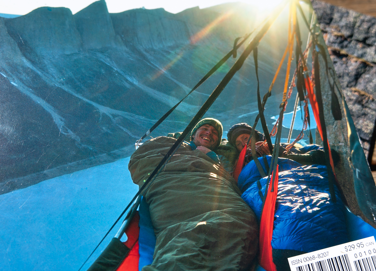 Marc-André Leclerc  and Brette Harrington tucked in at their hanging camp on pitch 10 of Northwest Turret on Great Sail Peak, Baffin Island. Photo: Josh Lavigne.