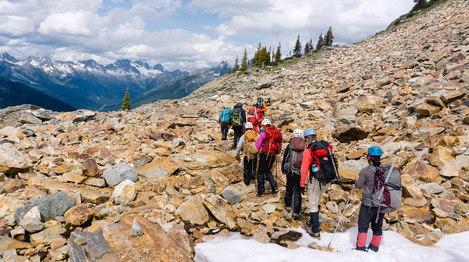 Girls travel up Youngs Peak in all their gear.