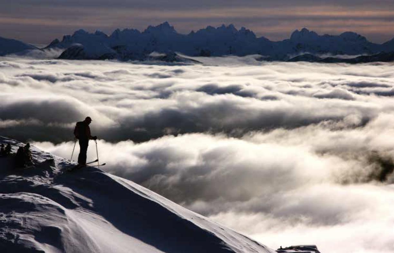 John above a sea of clouds near Mt Cain, Vancouver Island, 2012. Photo Linda Bily
