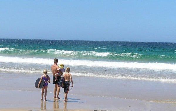 Family on the beach.jpeg