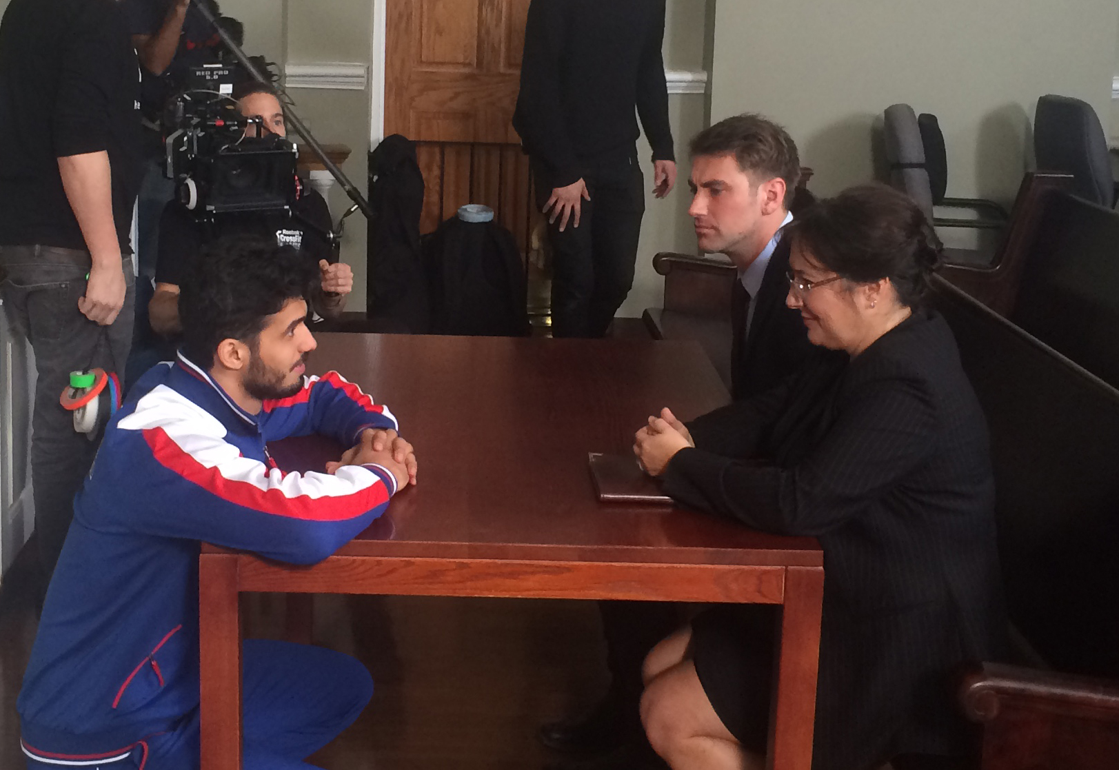 Ramazan Nanayev speaking to actors on set