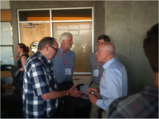 Figure 1: Life-time membership awardee, Andrew Nevin (left), talks to Carlos Salas (right), GeoscienceBC , about his lifelong career in exploration.