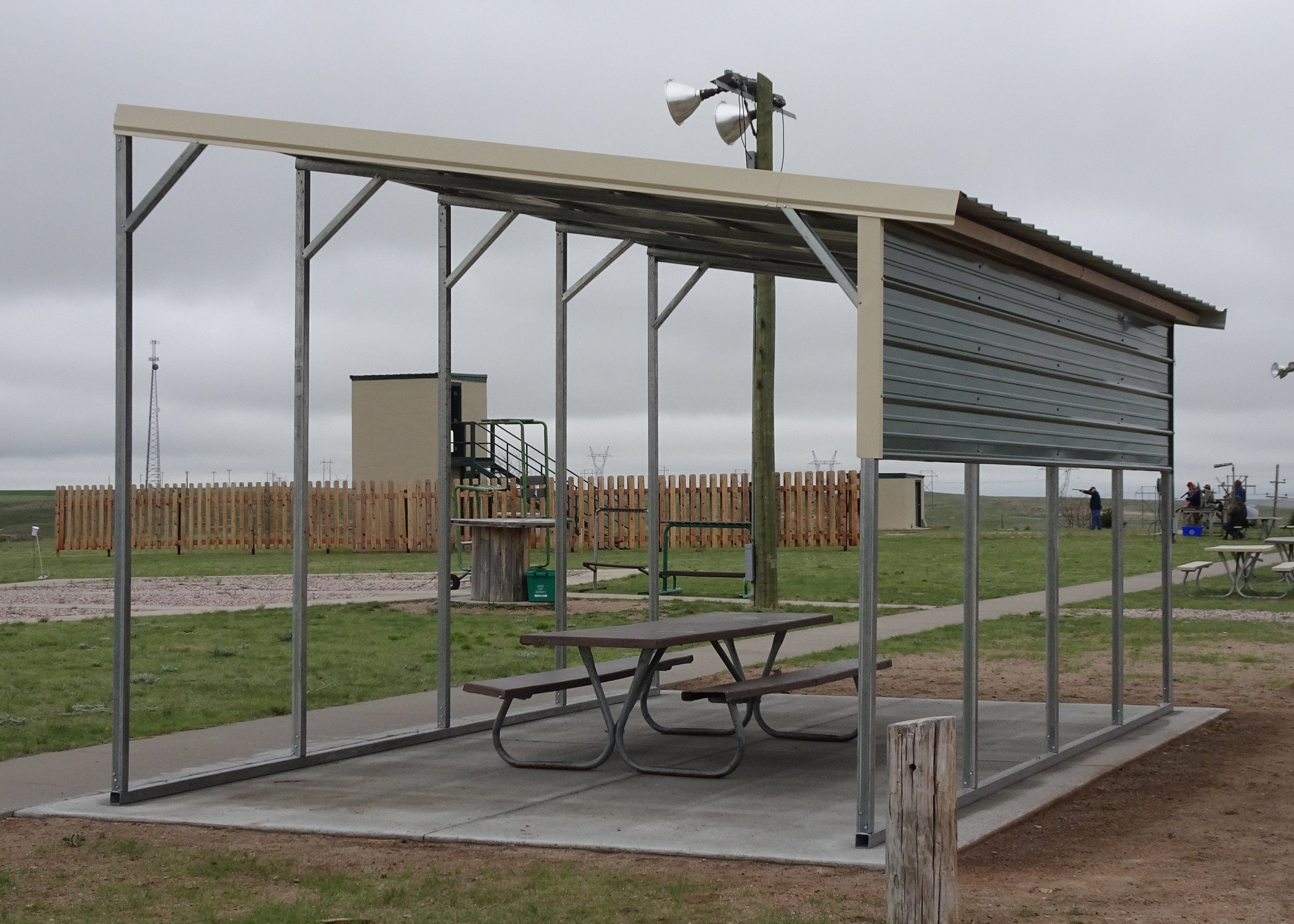 NEW FOR 2018! Shade Structures! - The Sidney Shooting Park has received grant money from the NRA Foundation to build shade structures next to the Trap fields. We now have dugout-style lean-to structures on cement pads, with new gun racks made by Brad Zalesky of Performance Automotive and Towing!