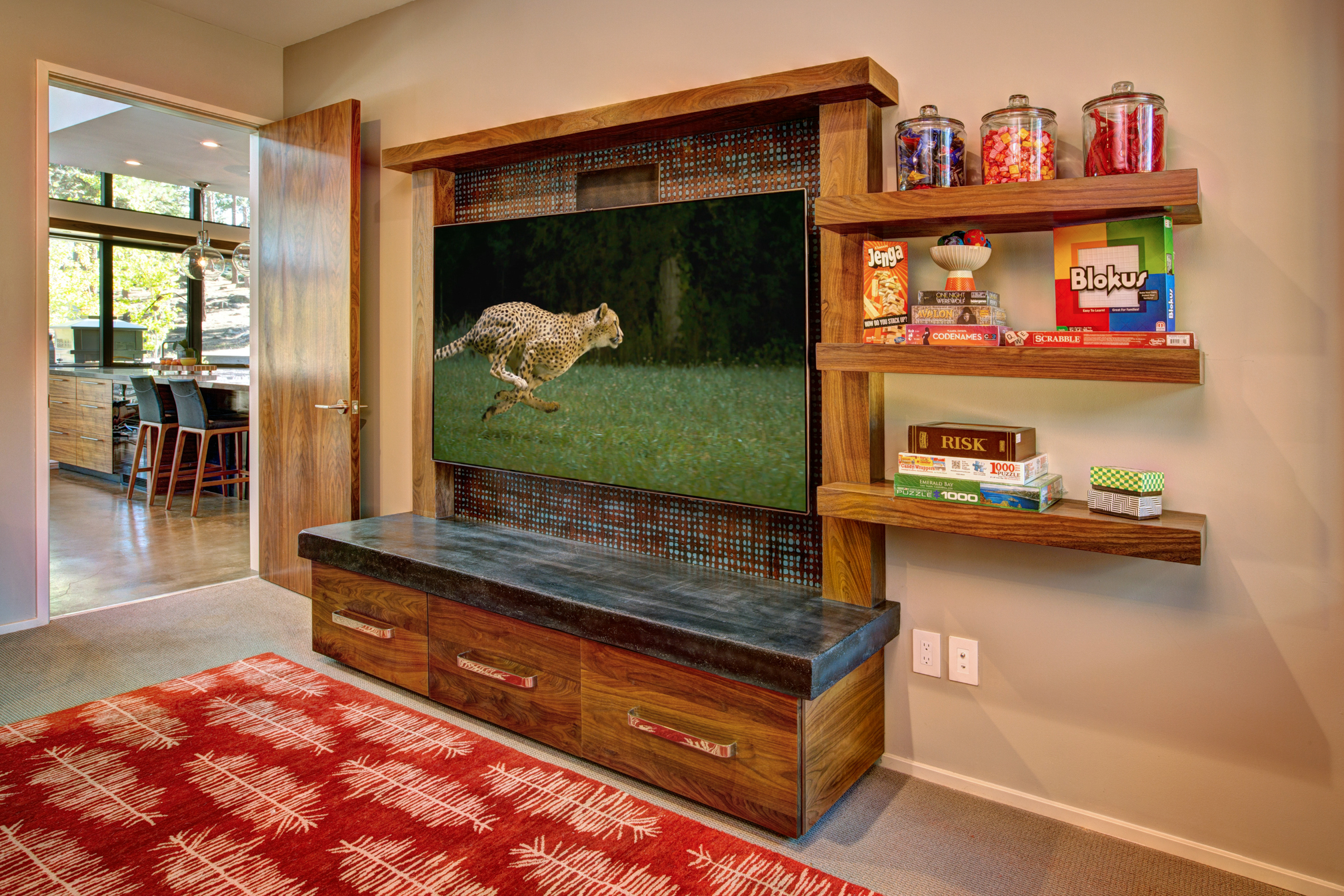 Walnut Entertainment Center with Storage Drawers and Concrete Top.