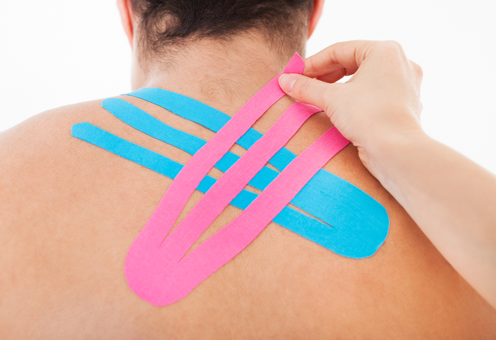 bigstock-Applying-Special-Physio-Tape-O-63623407.jpg