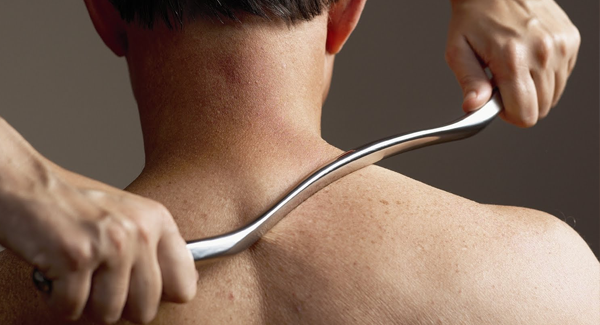 instrument-assisted-soft-tissue-mobilization-calgary-chiropractor.png