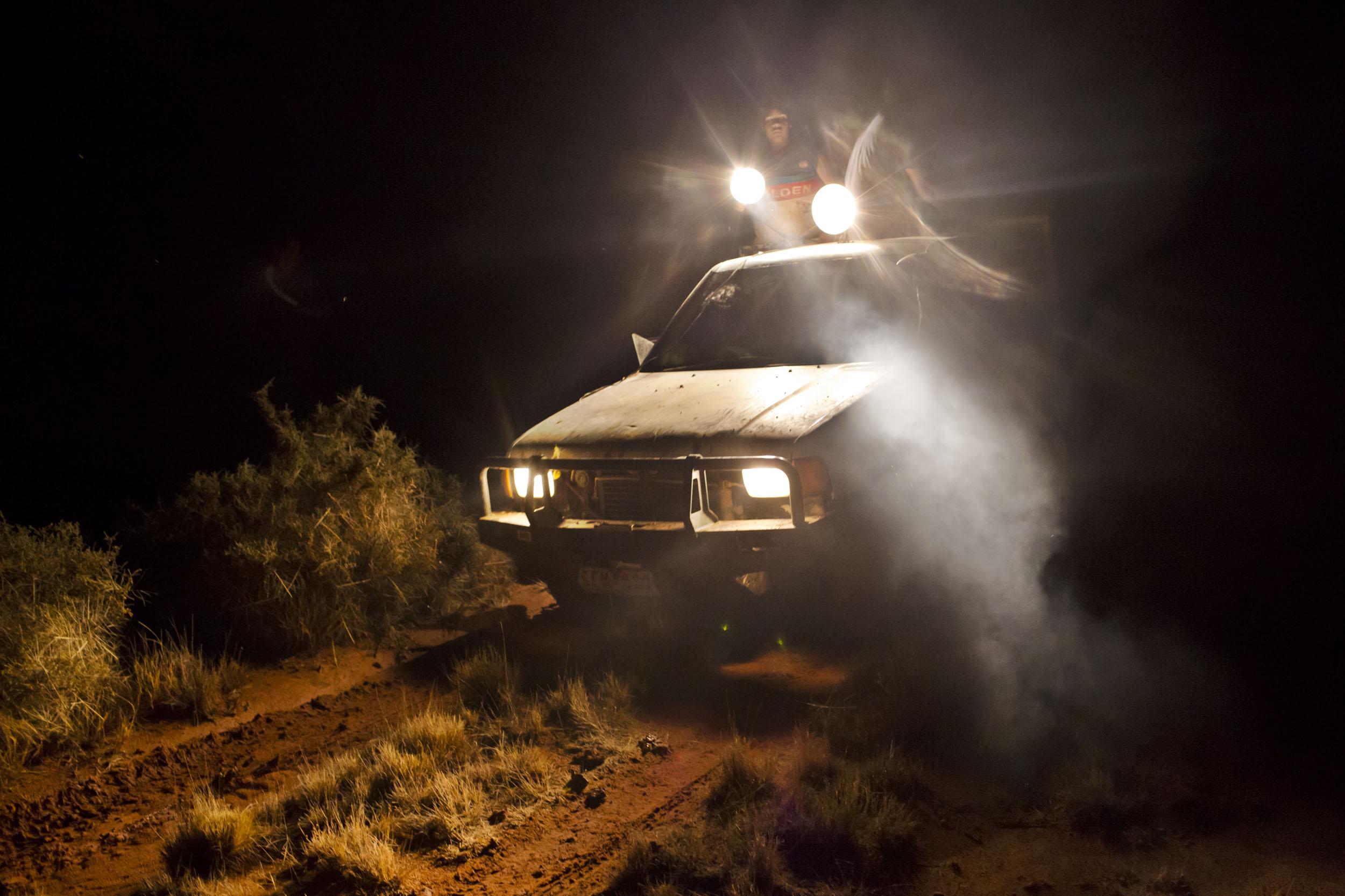Barkindji men use a spotlight during a nighttime hunt in Wilcannia, NSW.