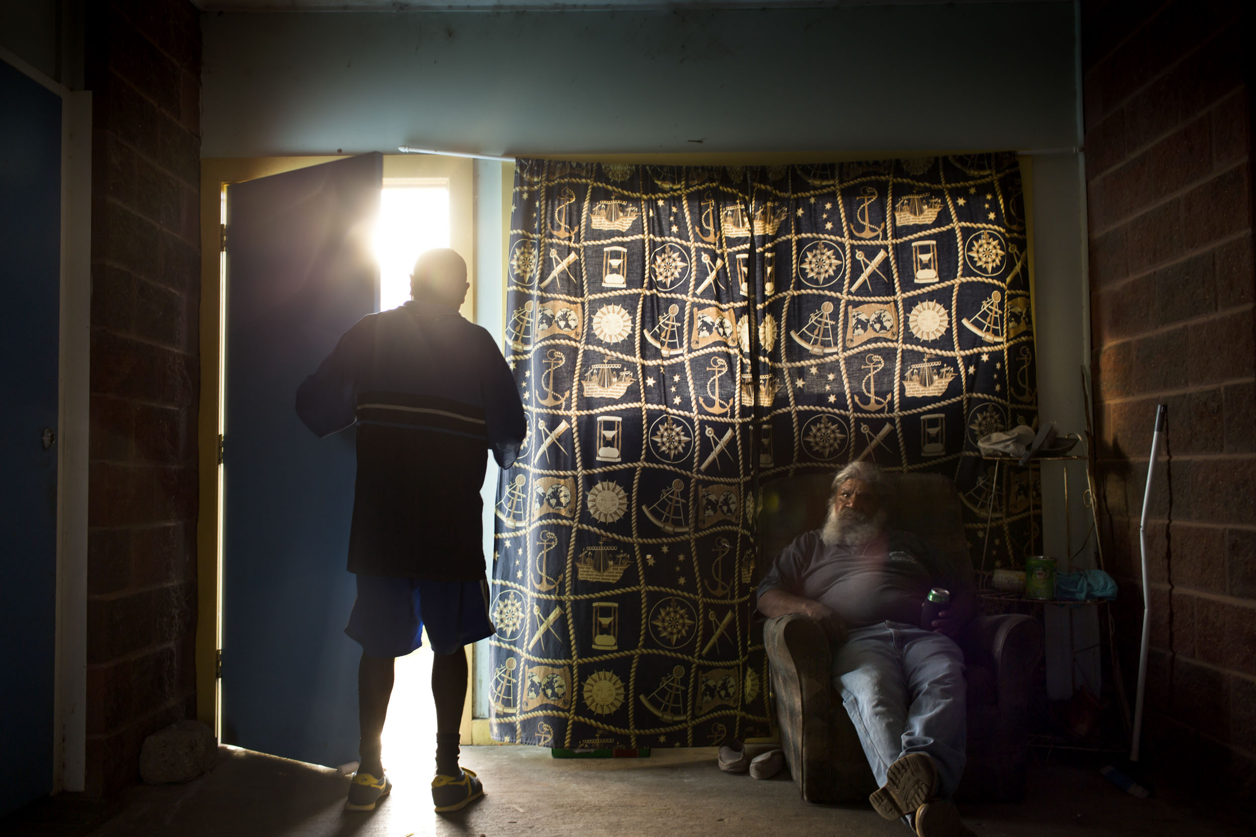 Men relax inside and out of the heat of the day in Wilcannia, NSW.