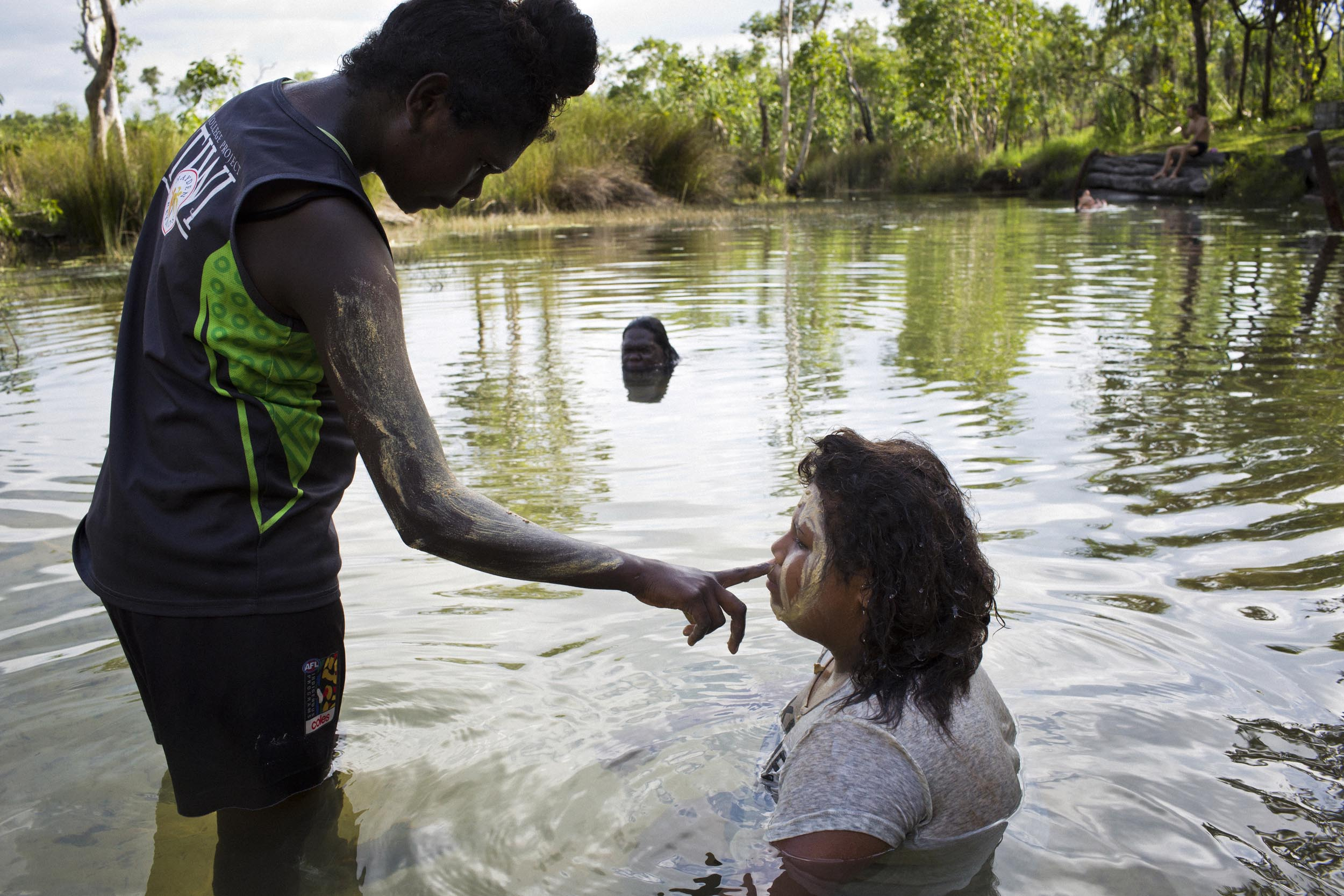 Young women swim in a freshwater spring on Melville Island, Northern Territory.
