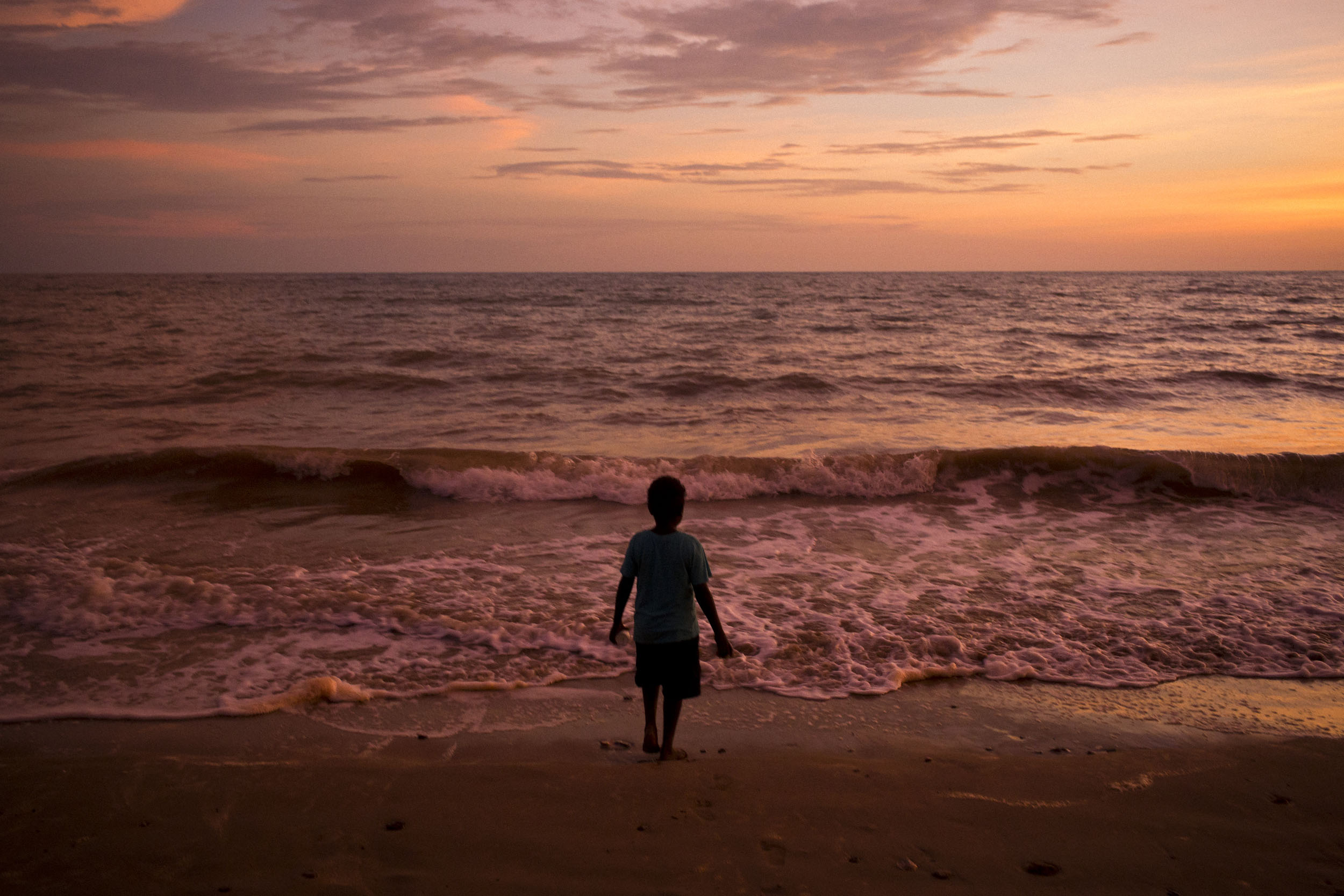 A boy along the shoreline of Melville Island, Northern Territory.
