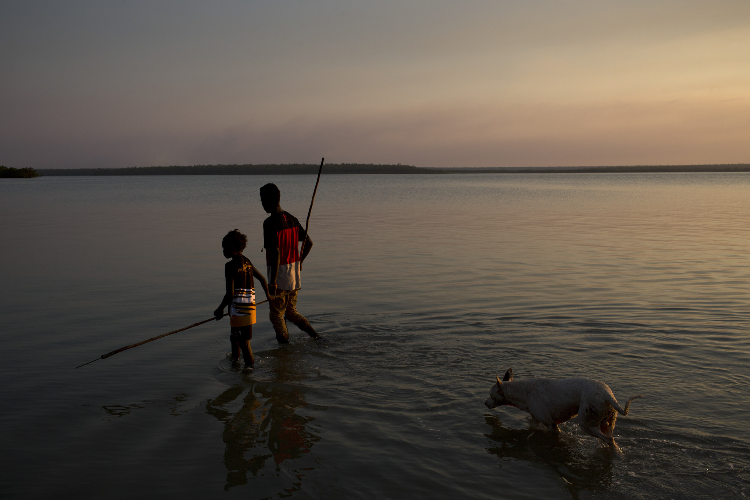 Boys hunt with traditional spears on Melville Island, Northern Territory.