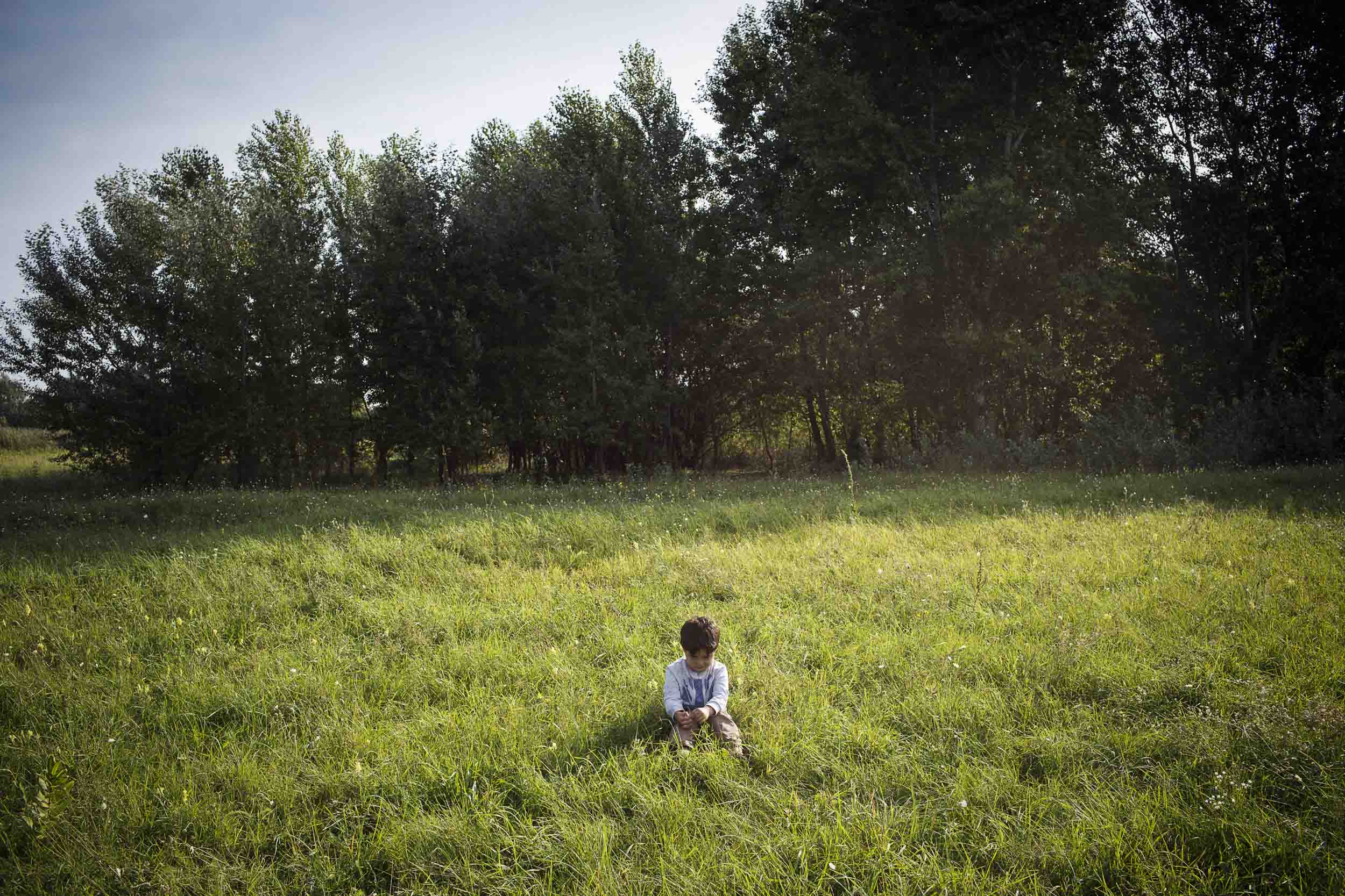 Horgoš, Serbia. A young refugee boy separated from his parents at the Serbia/Hungary border.