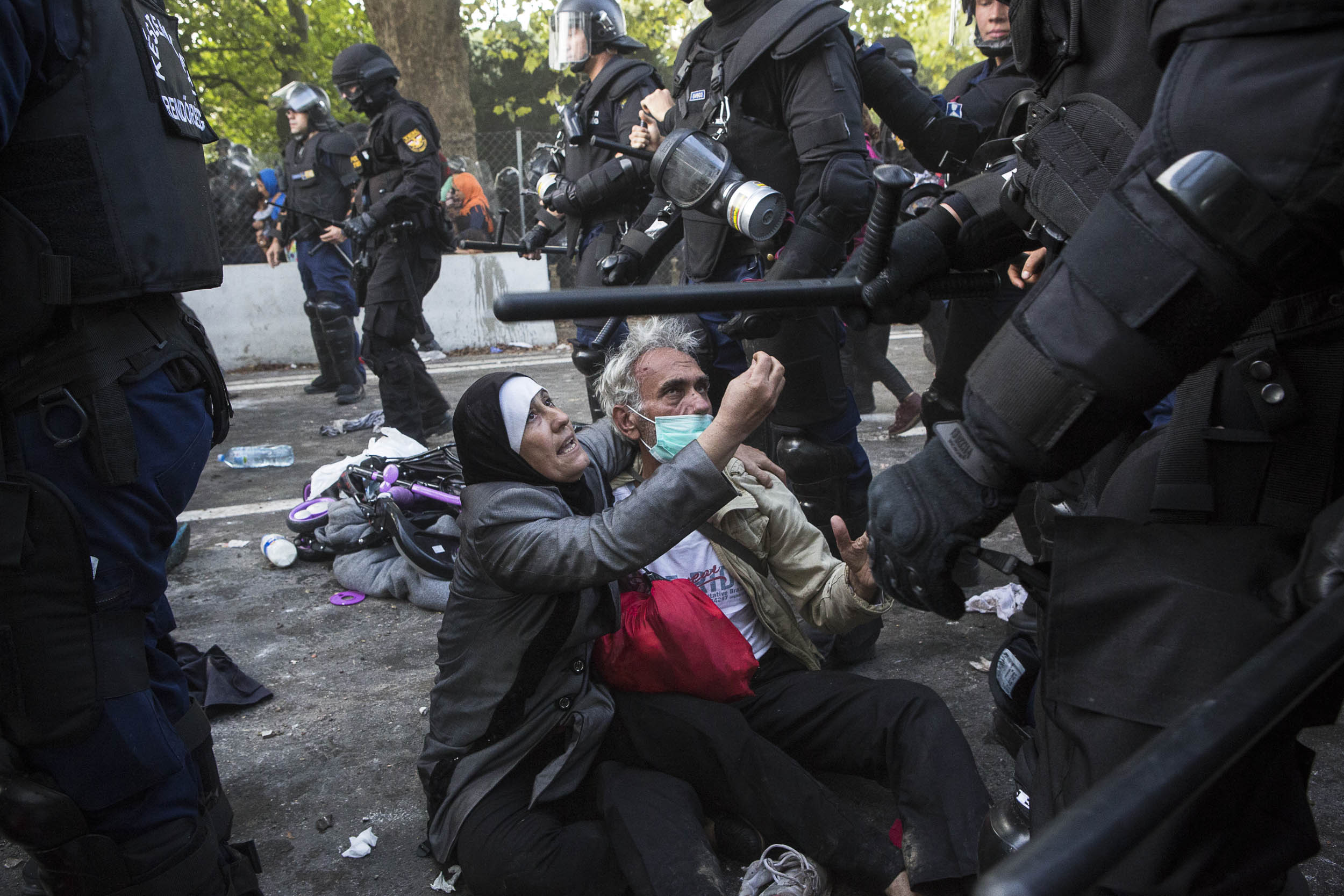 Horgoš, Serbia. Refugees caught up in violence between desperate refugees and Hungarian police at the Serbia/Hungary border.