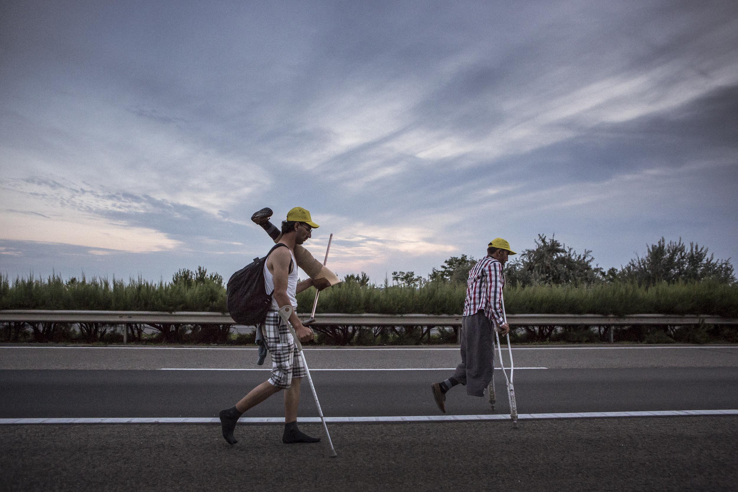 Outside Budapest Hungary. Syrian refugees travel along the M! highway bound for the Hungary/Austria border.