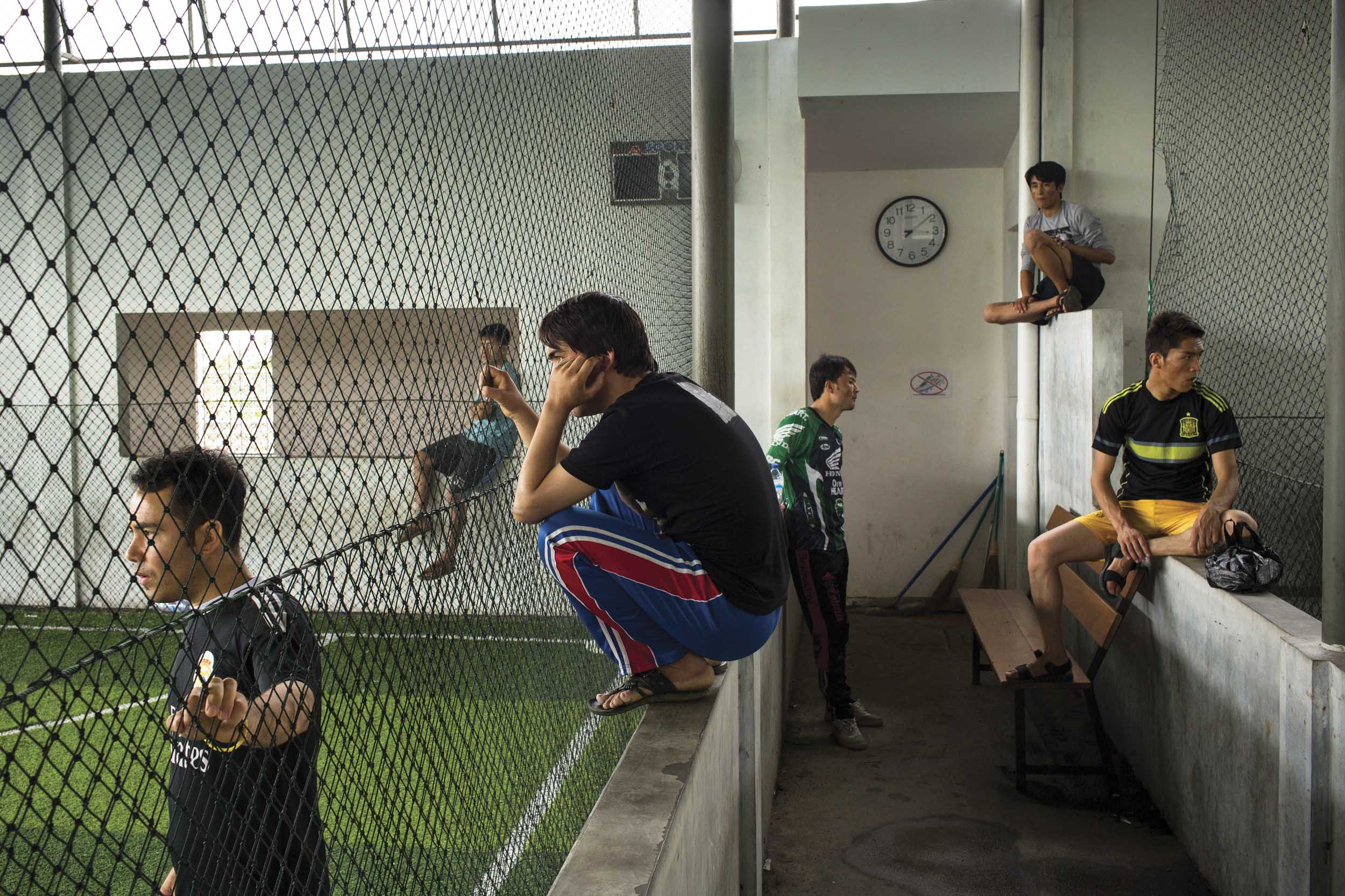 Cisarua, West Java, Indonesia. Hazara asylum seekers at the local indoor soccer pitch in Cisarua.
