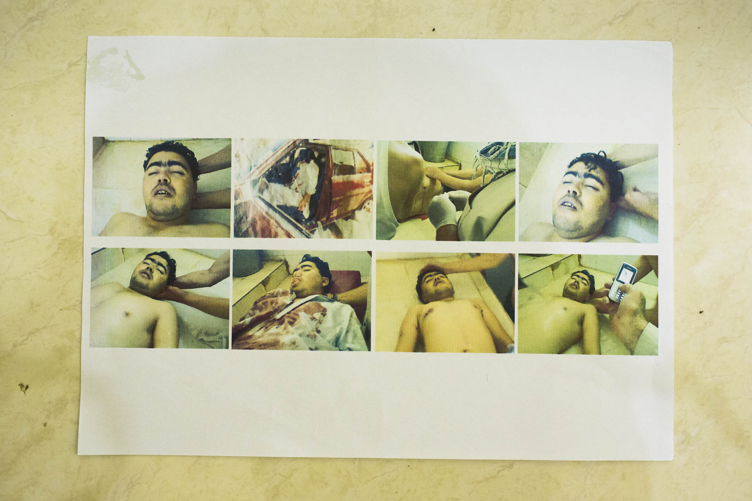 Cisarua, West java, Indonesia. A document  belonging to a Hazara asylum seeker shows his nephews body after he was killed in an attack in Pakistan.