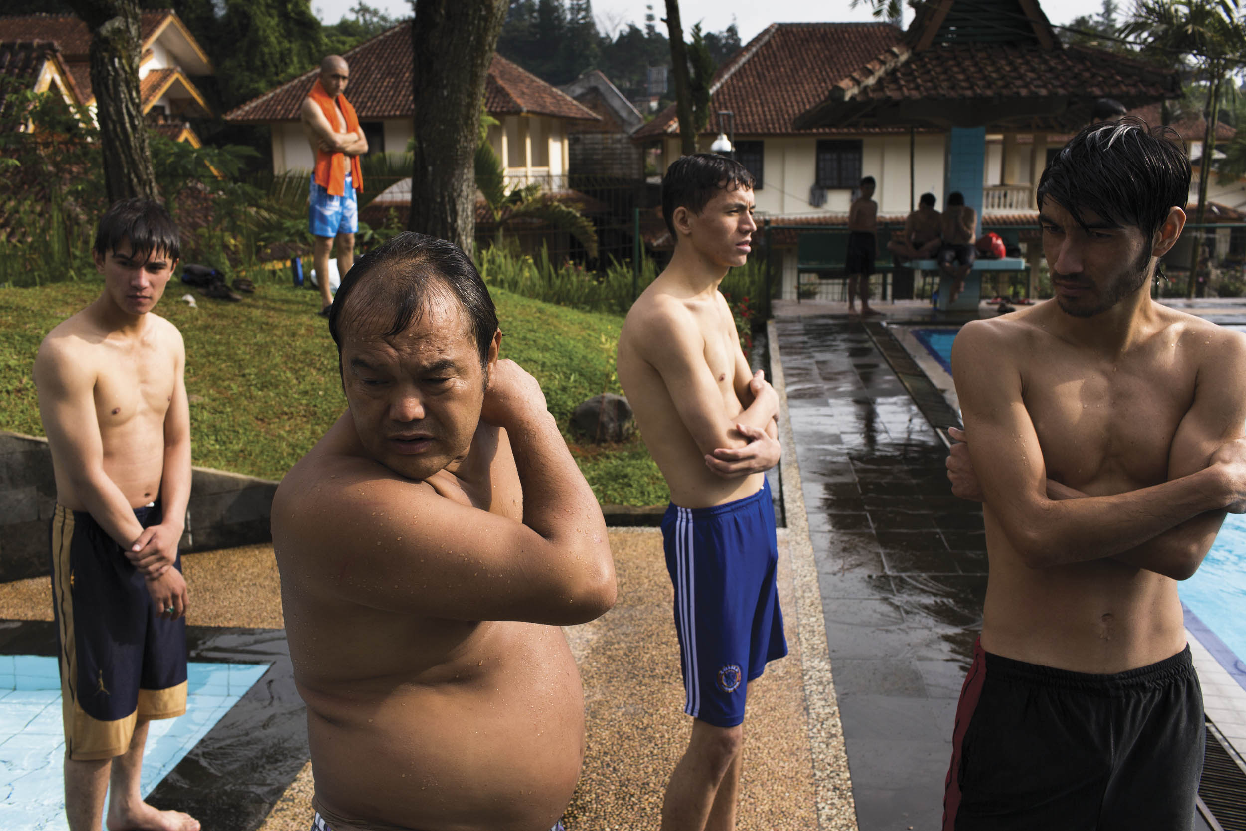Cisarua, West Java, Indonesia. Ethnic Hazaras from Afghanistan and Pakistan swim at the local Evergreen pool in Cisarua.