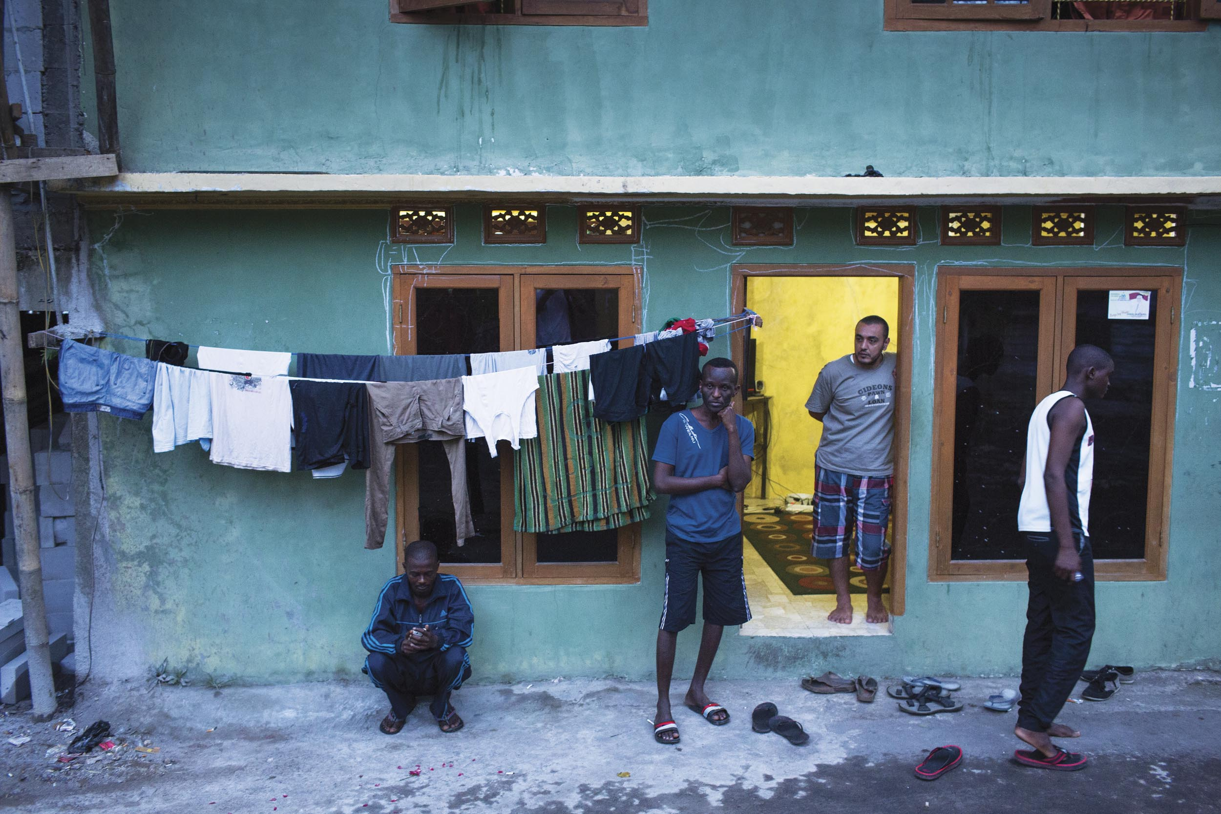 Cisarua, West java, Indonesia. Asylum seekers from African countries outside their shared apartment in Cisarua.