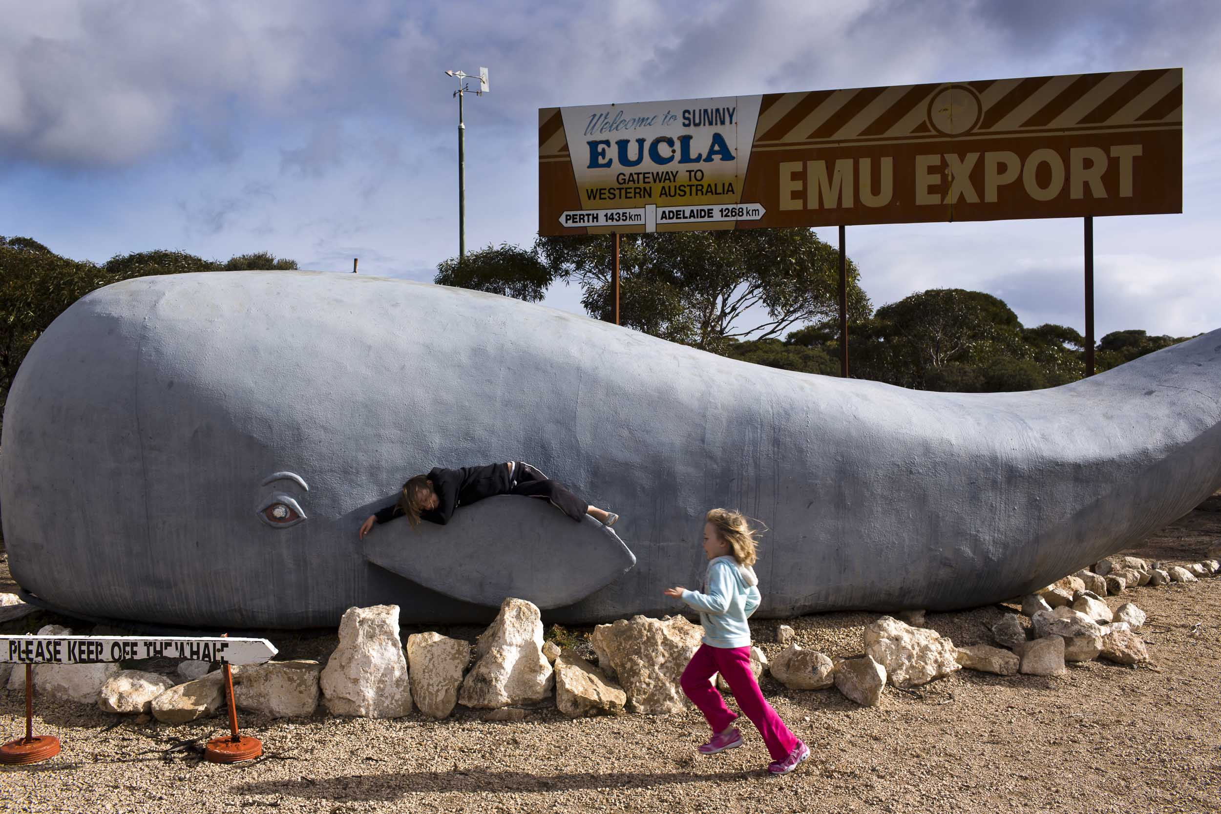 Children play on a whale statue in the Western Australian town of Eucla along the Eyre Highway, Eucla, Western Australia.