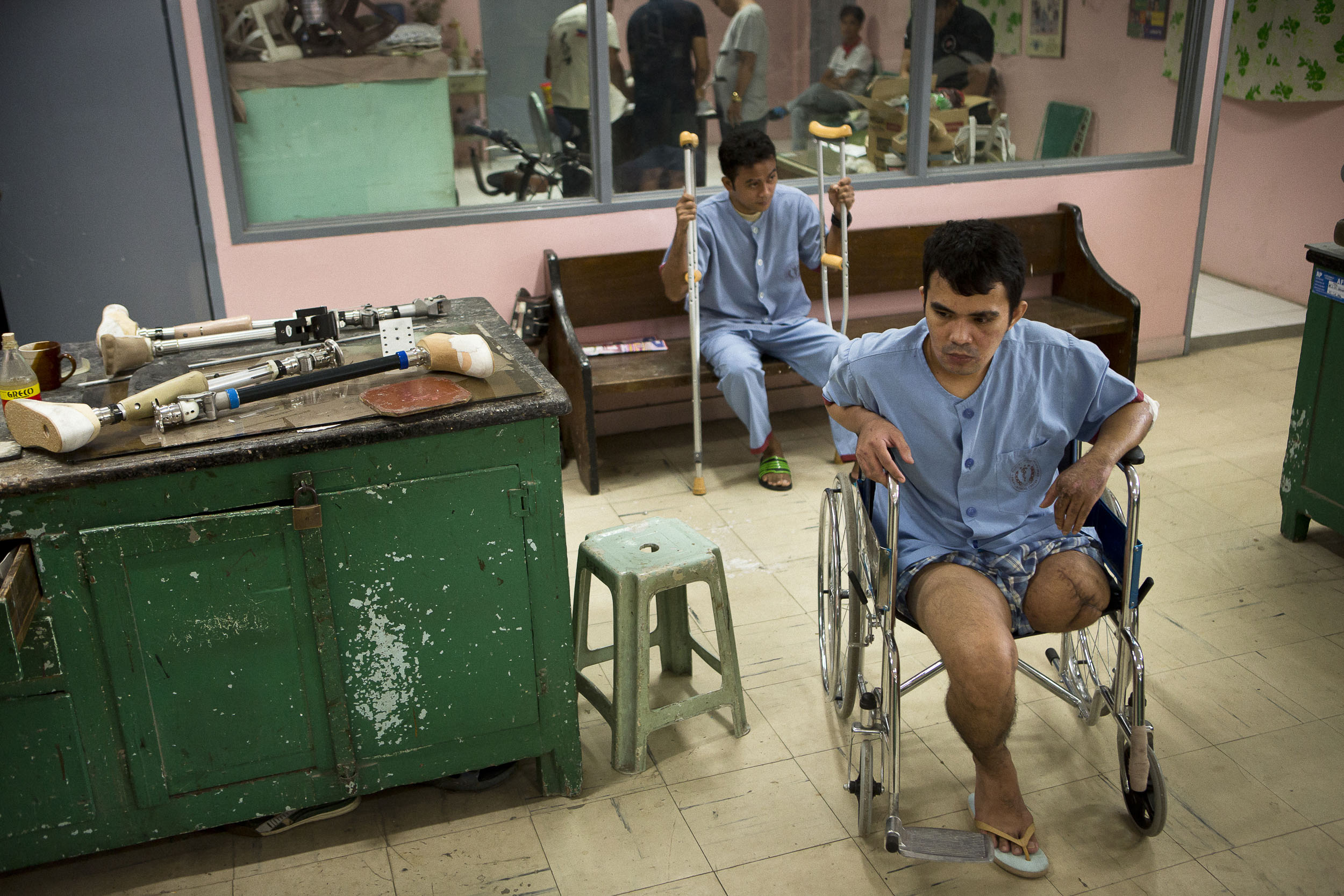 1st Scout Ranger Special Operations Corporal Jerick Milar (right) waits to be fitted for a prosthetic leg at the V Luna General Hospital in Manila. Milar was injured August 23rd, 2017 in Marawi by an Improvised Explosive Device.