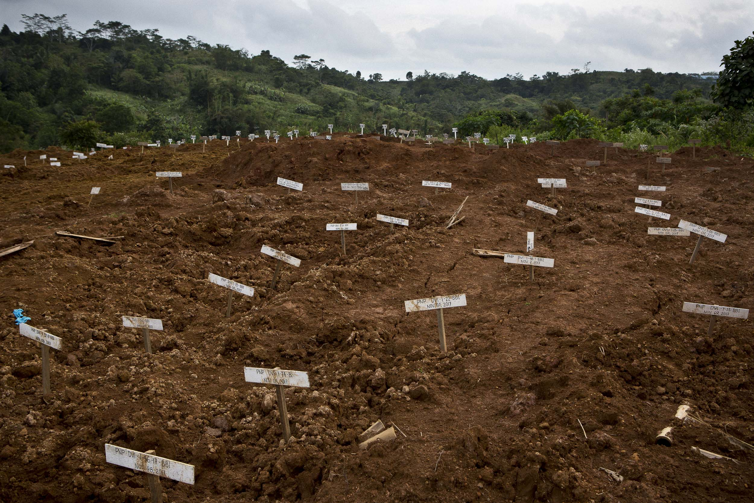 A temporary burial site for unidentified bodies killed during the siege of Marawi. Each grave has been identified with a code that corresponds with data collected from the corpse in hopes of later identifying the body.