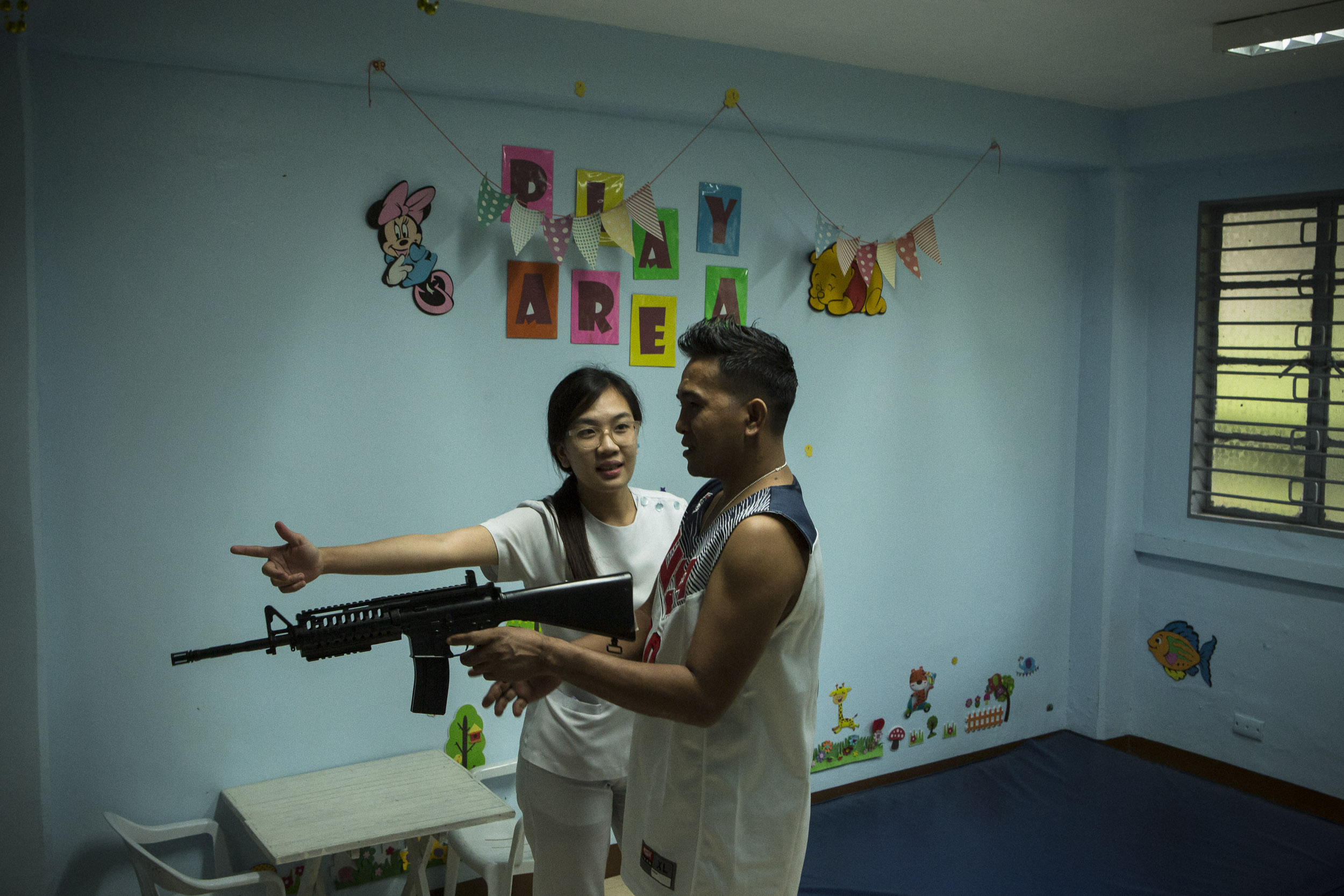 A special forces soldier injured in the Marawi siege works to regain the use of his hand with an occupational therapist at the V Luna General Hospital in Manila.